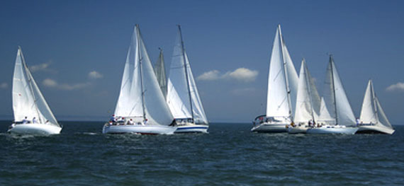image of sailing yachts at the start of a race