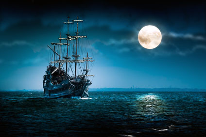 image of sailing ship in the moonlight