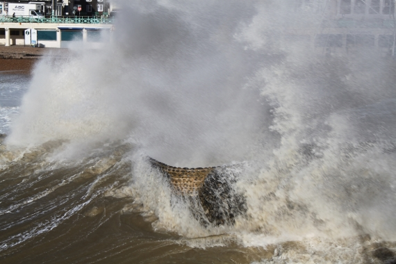 image of Waves breaking over groin in rough weather
