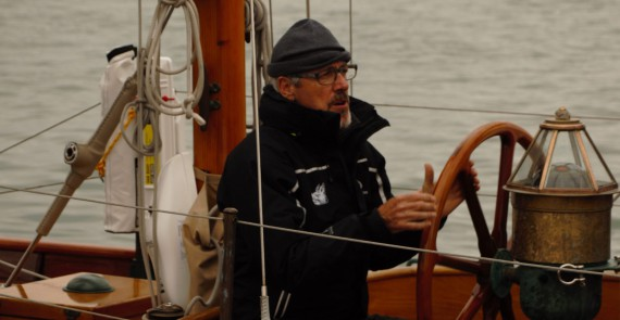image of TV comedian Griff Rhys Jones helming his yacht