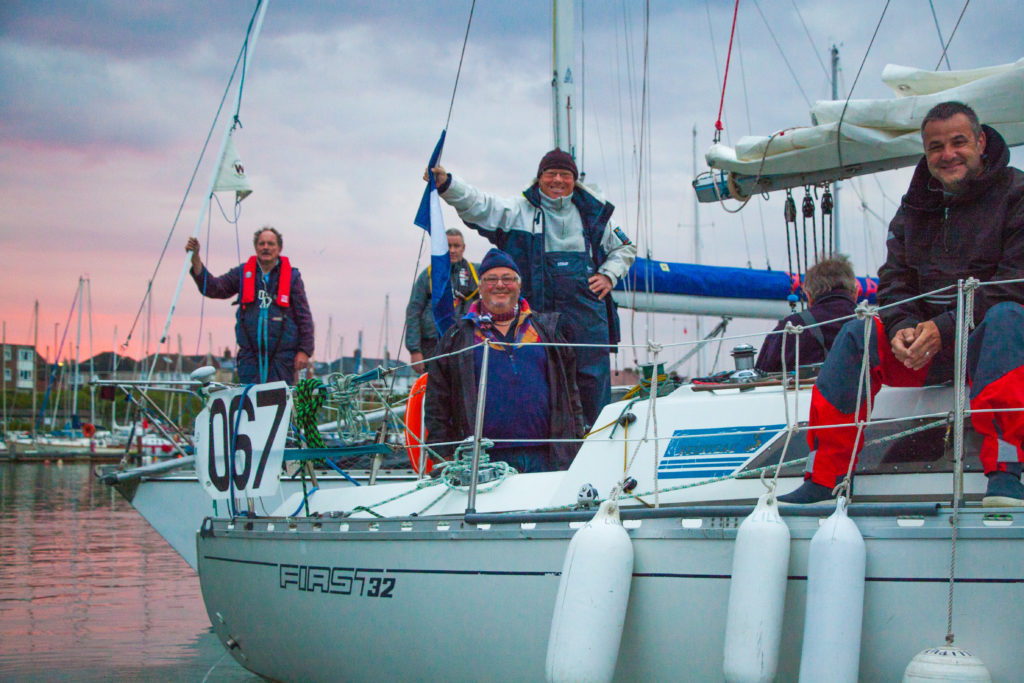 image of Cheerful sailors on a French flagged yacht