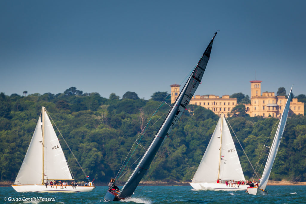 image of Cowes, Isle of Wight, UK - 19 July 2016 - Panerai British Classic Week 2016 Pegasus and Gryphis with Osborne house in the background photo credit Guido Cantini