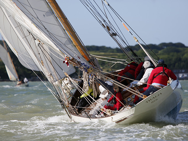 image of Thalia, built in 1888, is the oldest boat in this year's Race, helmed by David Aisher. Image: Patrick Eden