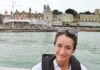 image of Magenta Edwards the-news.co's culture and arts editor against a backdrop of the starting line at the RYS Cowes