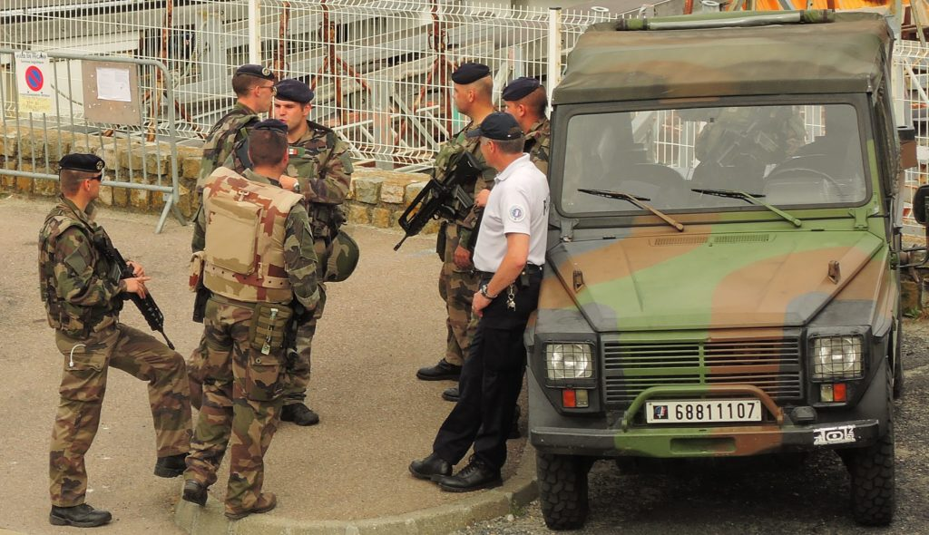 image of French troops standing with local Police in Fecamp