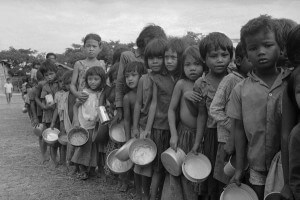 image of My lodger's mum in 1975? Cambodian refugee children, wait for food at aid station outside of Phnom Penh. (AP Photo/Tea Kim Heang aka Moonface)