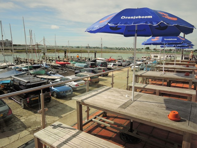 image of Sussex Yacht Club's empty veranda looks out over the narrow strip of land used by local residents for convenience parking.