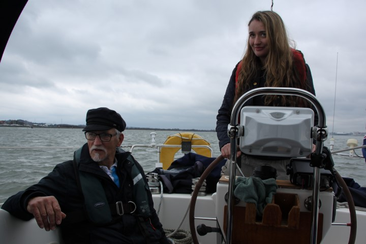 Image of Sdn Ldr (rtd) David Le Mare kindly giving Magenta helming instruction on board Lady Penelope