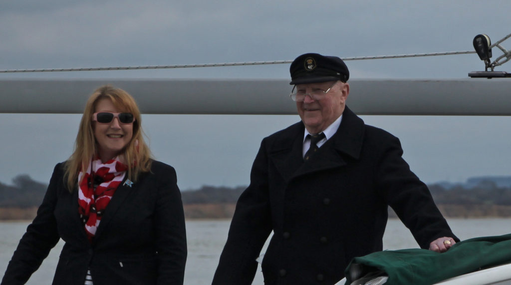 image of RAFYC commodore Gail Foster and club admiral Flt. Lieut. (rtd) John Chitson take the salute at the sail past