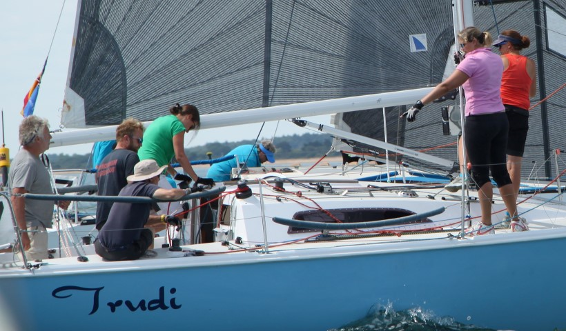 Yacht Trudi approaching a mark readies for a spinnaker gybe
