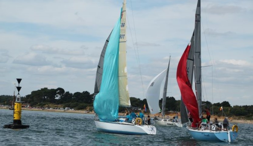 Yachts rounding a mark near Beaulieu River entrance in the Solent