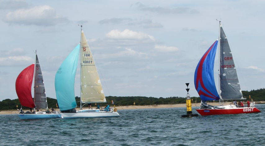 Yachts were able to fill their spinnakers despite the light airs