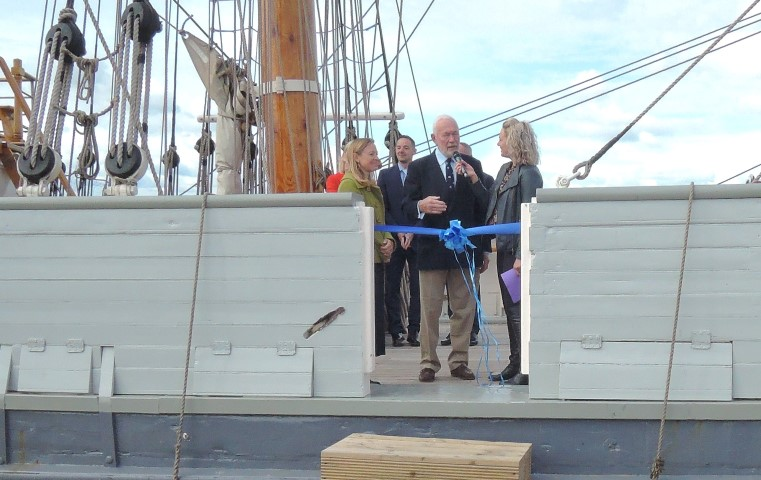 image of Sir Robin Knox Johnson opens the boat show from the deck of Kaskelot