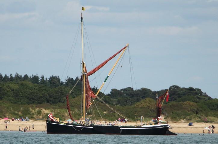 image of traditional sailing barge anchored near Beaulieu River entrance