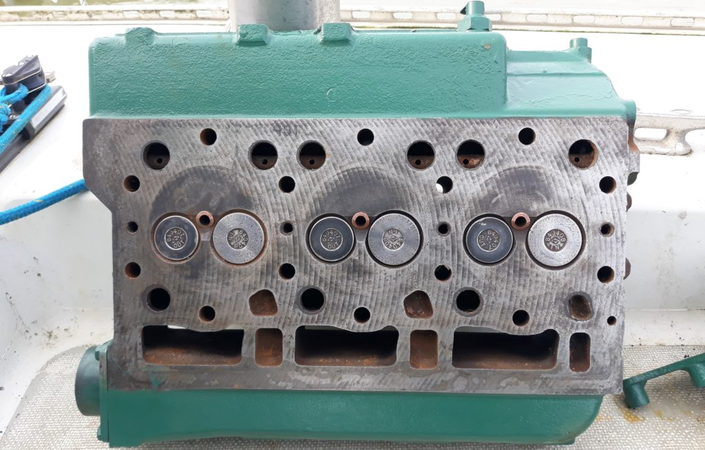 image of The engine head all clean with valves re-seated. Note the brass injector nozzles all cleaned out